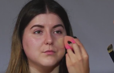 Beauty blender used to apply foundation to woman's face