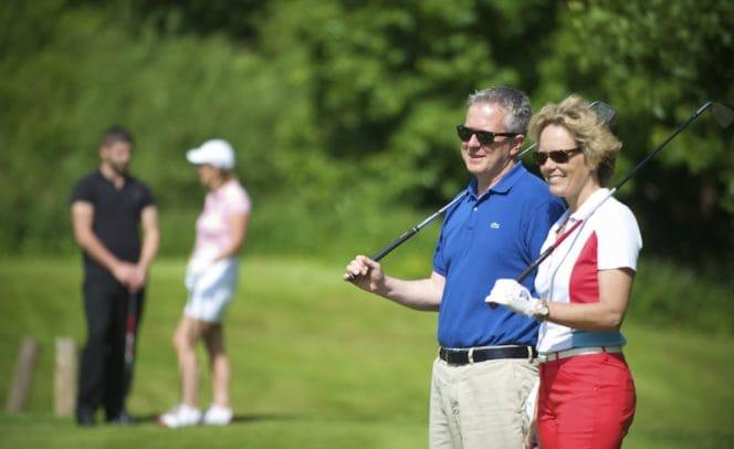 Couple Golfing at Stoke by Nayland