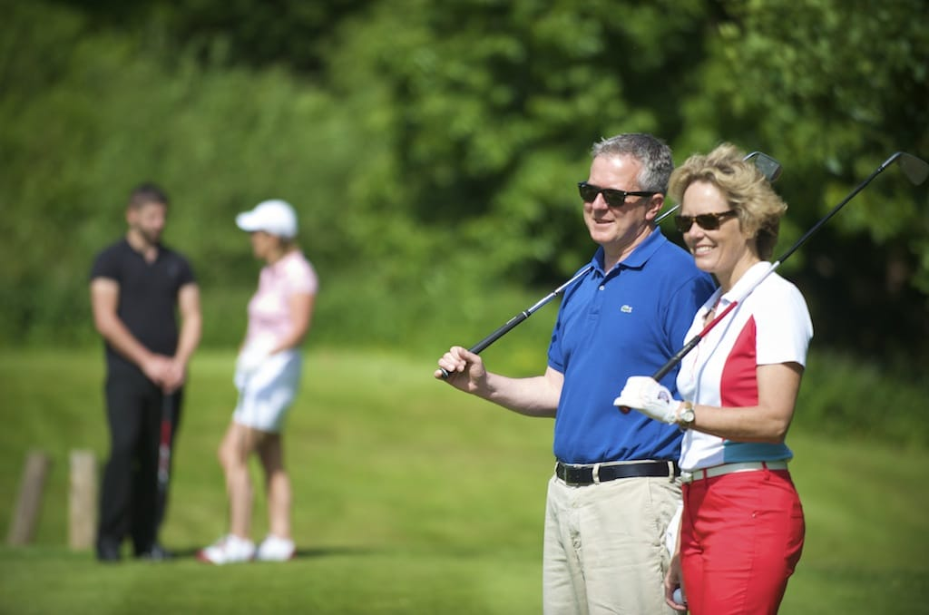 Couple Golfing at Stoke by Nayland