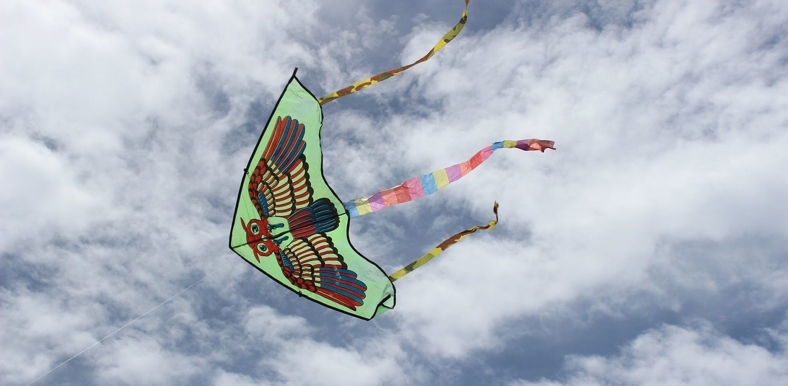Kite flying with clouds