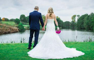 Wedding couple by lake