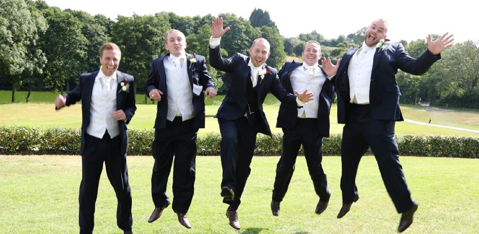 Wedding photo grooms party jumping