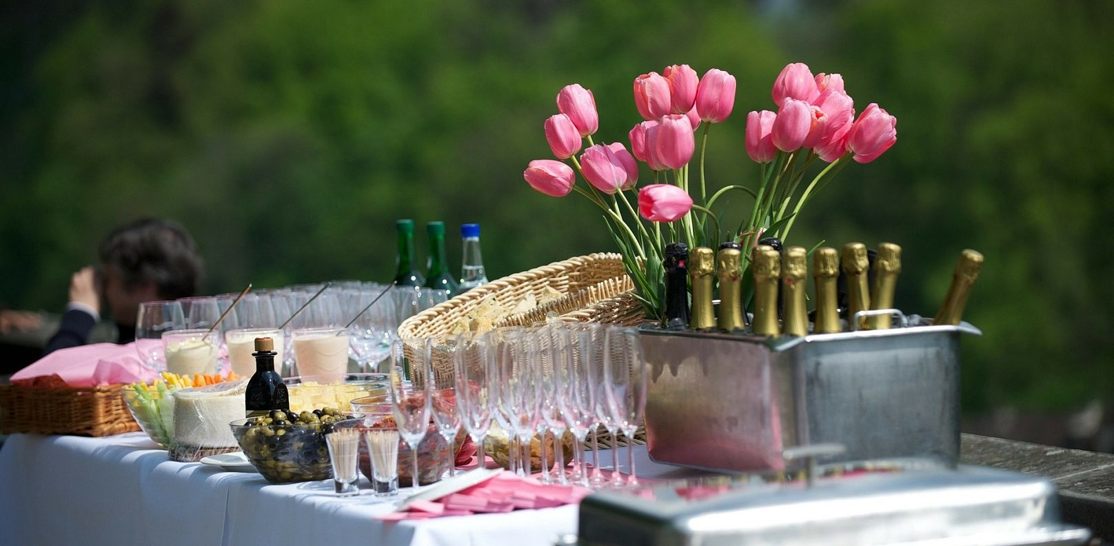 Wedding table with flowers, champagne, and glasses