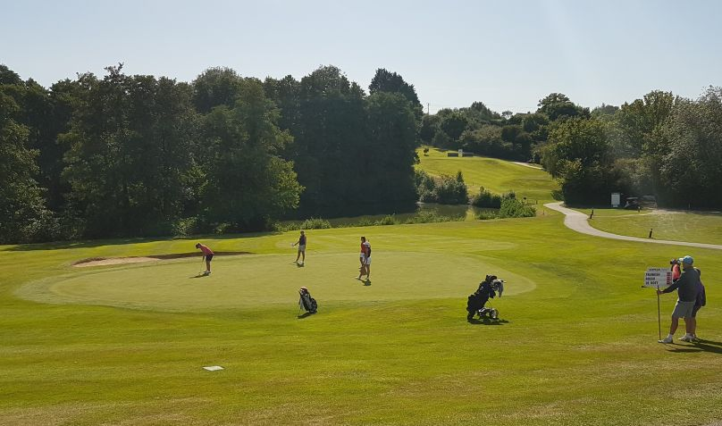 Manon sinks the winning putt on the 18th Gainsborough