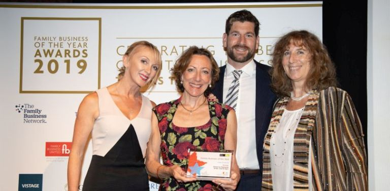 Tamara Unwin, Susanna Rendall and Robert Rendall, family directors at Stoke by Nayland Hotel, receive their award from Esther Wood (left) of sponsors Goodman Jones.