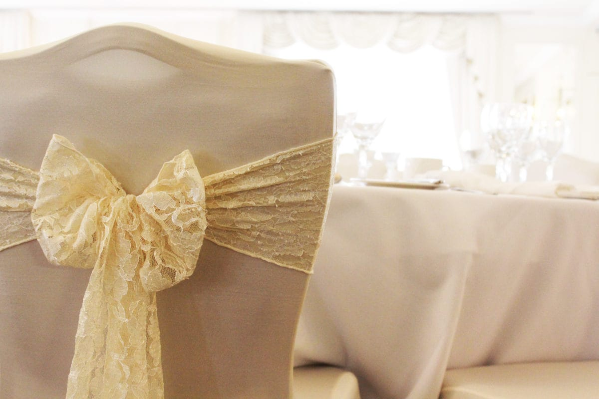 Chair covers with gold ribbon